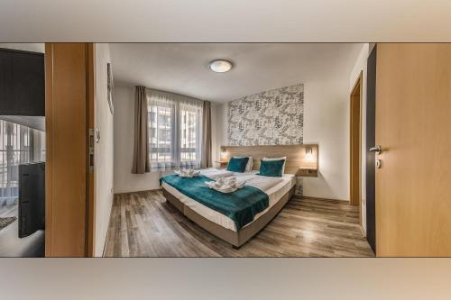 Ένα ή περισσότερα κρεβάτια σε δωμάτιο στο Mango Aparthotel