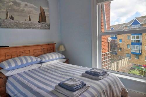 A bed or beds in a room at Gray's Inn