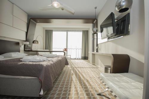 Łóżko lub łóżka w pokoju w obiekcie Marine Apartament