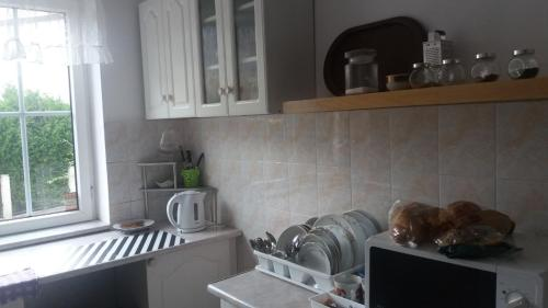 A kitchen or kitchenette at Gostinyi dom Warszawa