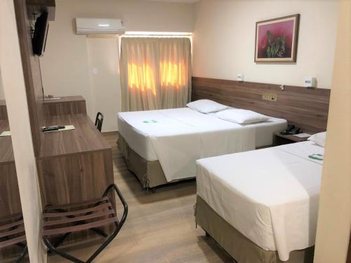Cama ou camas em um quarto em Hotel Vale Verde