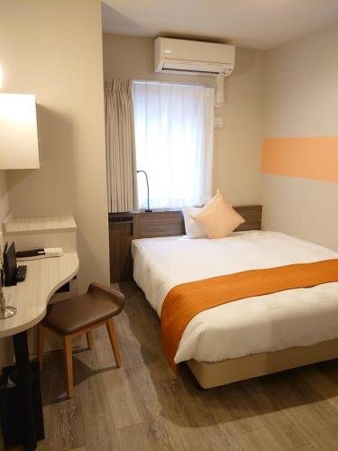 A bed or beds in a room at SARASA HOTEL Dotonbori