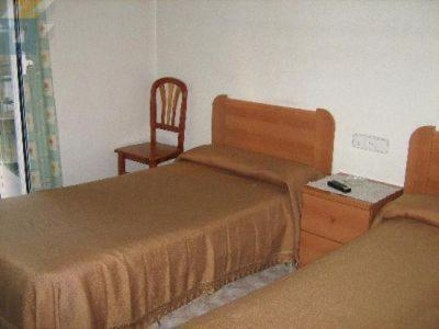 A bed or beds in a room at Hostal Casanova