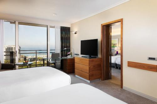 A television and/or entertainment center at Hilton Tel Aviv Hotel