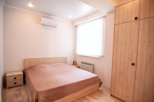 Кровать или кровати в номере Апартаменты в Сочи