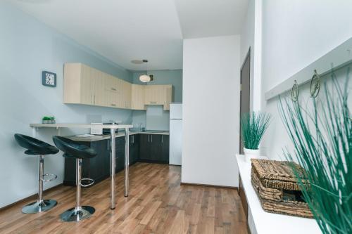 A kitchen or kitchenette at Lara Apartment