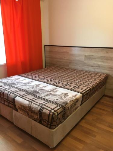 Кровать или кровати в номере Студии Маджента
