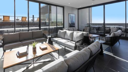 A seating area at Avani Melbourne Box Hill Residences
