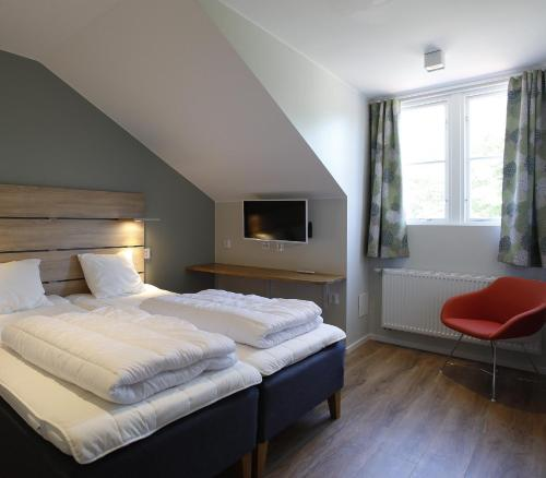 A bed or beds in a room at Kviberg Hostel and Cottages