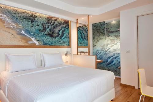 Кровать или кровати в номере Olive Green Hotel