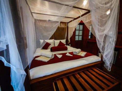 A bed or beds in a room at Levon Ella Sri Lanka