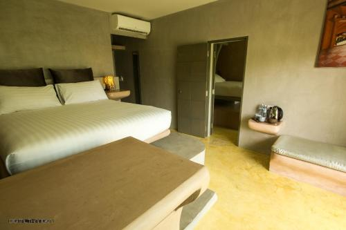 A bed or beds in a room at Le Divine Comedie Beach Resort