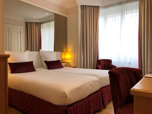A bed or beds in a room at MAISON LUTETIA R (ex Hotel Royal Lutetia)