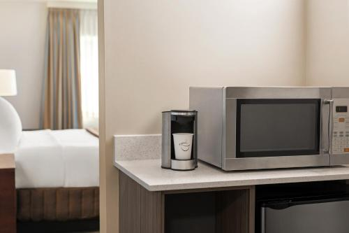 A television and/or entertainment center at Travelodge by Wyndham Calgary South