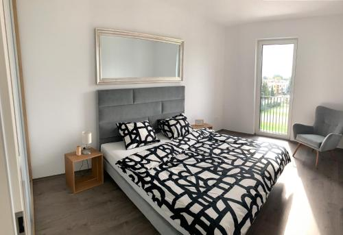 Posteľ alebo postele v izbe v ubytovaní Greenbay Golf Apartments
