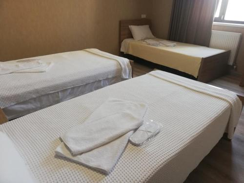 A bed or beds in a room at mtredebi