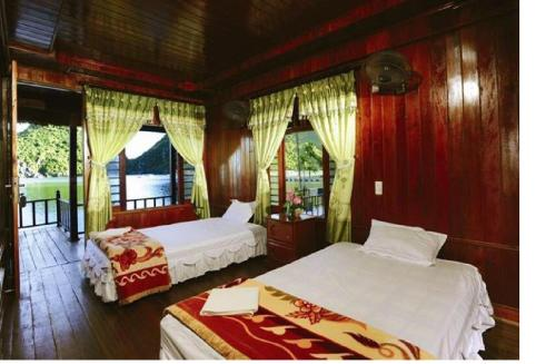 A bed or beds in a room at Cat Ba Sandy Beach Resort