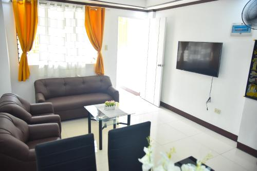 A seating area at Furnished House in Calapan City Subdivision near ROBINSON/XENTRO Mall