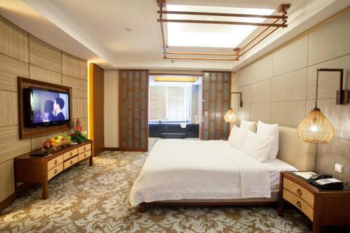 Ein Bett oder Betten in einem Zimmer der Unterkunft Harriway Garden Hotel