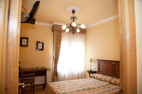 A bed or beds in a room at Jausoro