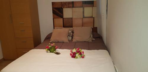 A bed or beds in a room at Sweet Inas