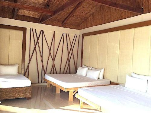 A bed or beds in a room at Kaiyana Boracay Beach Resort