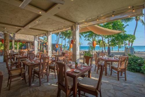 Restaurant ou autre lieu de restauration dans l'établissement Hotel Villa Taina