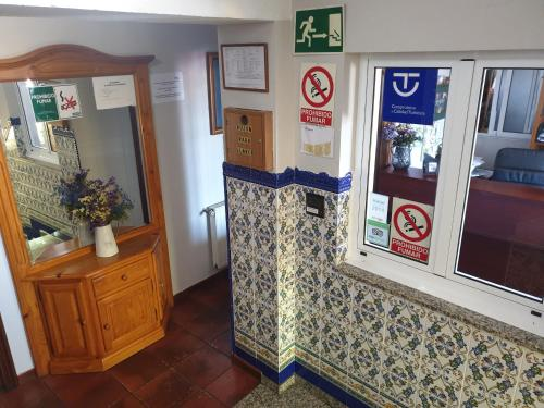 The lobby or reception area at Hostal Puente Azud