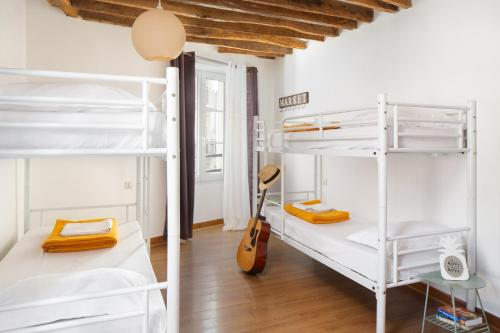 A bunk bed or bunk beds in a room at Le Village Montmartre by Hiphophostels