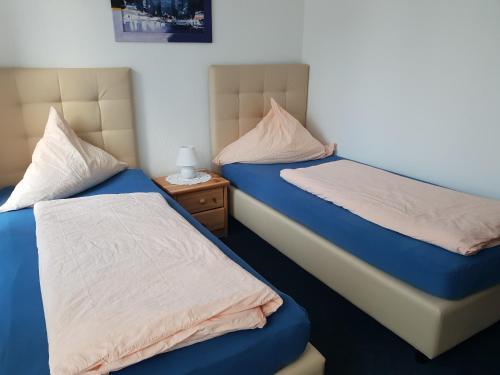 Ein Bett oder Betten in einem Zimmer der Unterkunft Hotel Baltic Residenz
