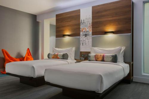 A bed or beds in a room at Aloft Liverpool By Marriott