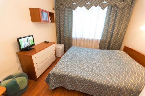 Кровать или кровати в номере Отель Паллада