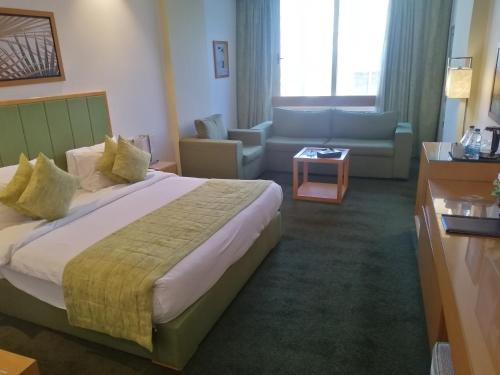 A bed or beds in a room at Tolip El Narges