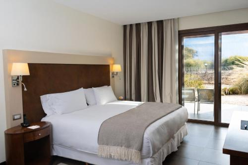 A bed or beds in a room at Grace Cafayate