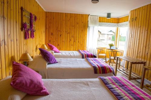 A bed or beds in a room at Hotel del Paine