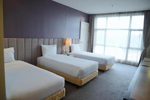 سرير أو أسرّة في غرفة في سيلكا تشيراس كوالالمبور