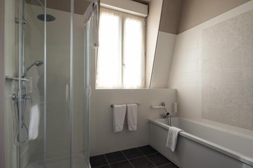 Salle de bains dans l'établissement Best Western Central Hotel