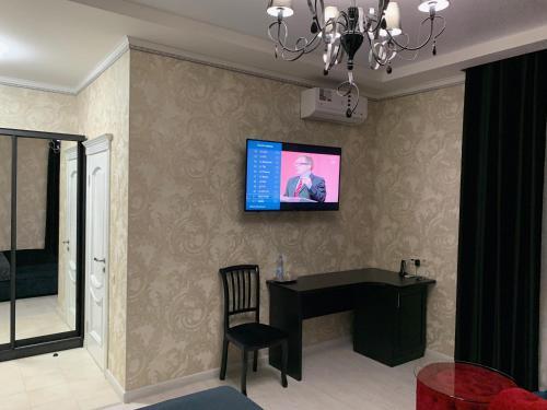 Отель Империяにあるテレビまたはエンターテインメントセンター