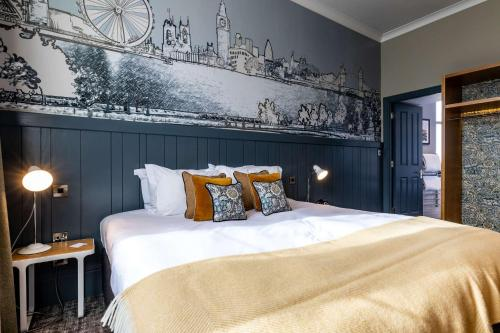 A bed or beds in a room at The Brook Green Hotel