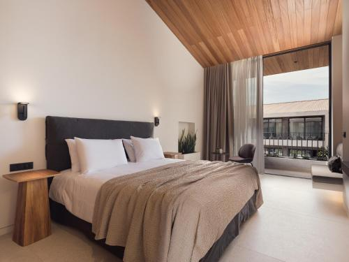 A bed or beds in a room at Contessina Suites & Spa - Adults Only