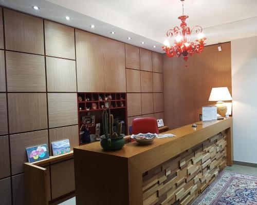 A kitchen or kitchenette at Giga Hotel