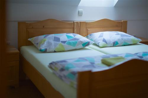 A bed or beds in a room at Tourist farm Lovrec
