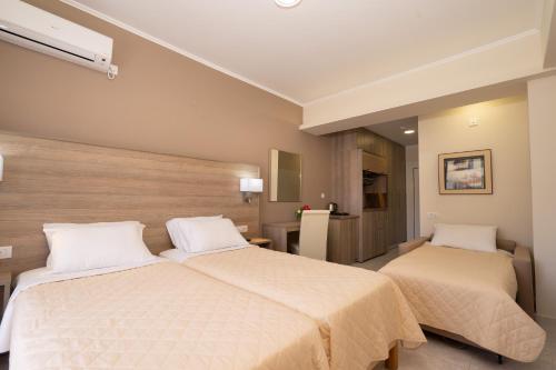 Letto o letti in una camera di Diamanto Complex