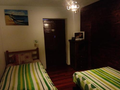 A bed or beds in a room at hostal casa del frailejon
