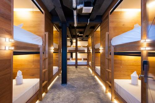 A bunk bed or bunk beds in a room at Indie Hostel - Koh Tao