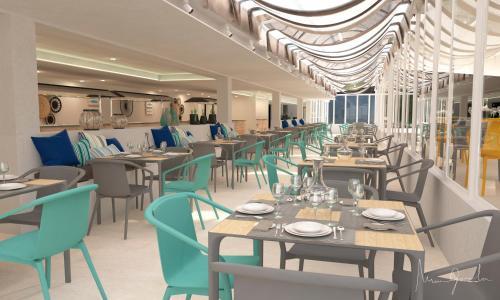 Een restaurant of ander eetgelegenheid bij Apartamentos Playa Moreia