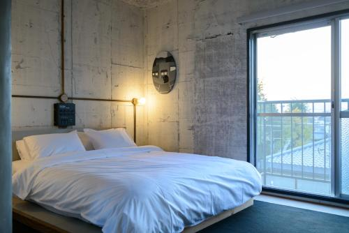 A bed or beds in a room at Rc Hotel Kyoto Yasaka