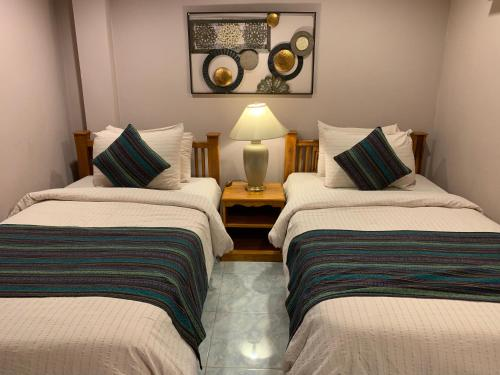A bed or beds in a room at Richmond Guesthouse Haad Rin