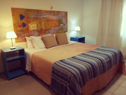 Una cama o camas en una habitación de Hotel Lunajuim