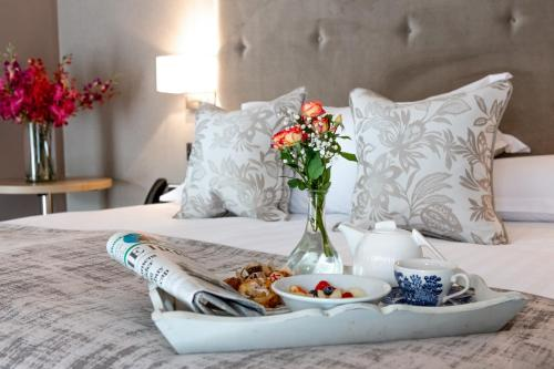 A bed or beds in a room at Gleesons Townhouse Booterstown
